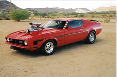Google Image Result for http://hooniverse.com/wp-content/uploads/2010/11/1971-Mustang-Mach-1-3.jpg