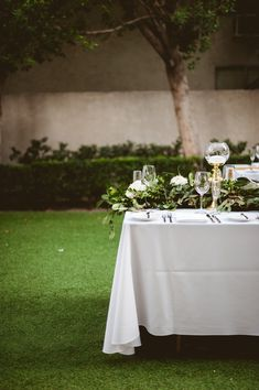 Candle lined Palm Springs wedding tablescape.