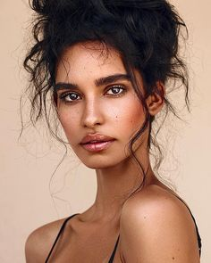 Hair - updo with messy waves. Dewy natural makeup with warm brown tones.