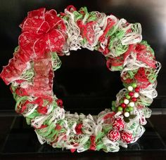 Christmas Wreath made from 3 skeins of starbella ruffle yarn. Sashay Crochet, Crochet Ruffle Scarf, Crochet Wreath, Crochet Snowman, Sashay Scarf, Crochet Hair, Ruffle Yarn Projects, Sashay Yarn Projects, Crochet Projects
