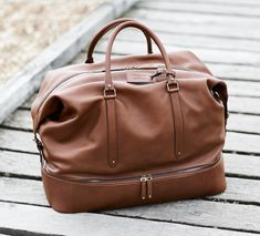 This large luxury leather holdall in cognac brown from Bentley is beautifully crafted in the finest materials. Order from the official Bentley Collection website today. Bentley Blower, Design Language, Cart, Gift Ideas, Luxury, Leather, Collection, Style, Covered Wagon