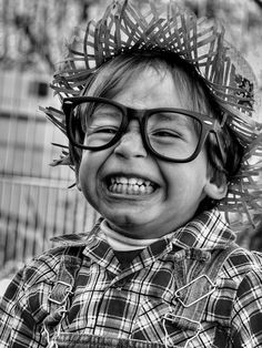 Smiling [:D] ~ photo by Melvin Quaresma  -  cute lil' boy with the big cheezy grin, straw hat and glasses...