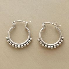 "SILVER BEAD HOOPS -- In these sterling silver bead hoop earrings, dainty sterling beads cling to sterling hoops, defining a look that will fast become your everyday go-to favorite. Exclusive. 3/4""L."