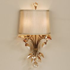 The exquisite Elena Crystal Leaf Metal Wall Sconce will look beautiful on any wall. Featuring burnished gold metal and golden teak glass crystal leaves, this wall sconce is sure to put your decor on the cutting edge of elegance. Victorian Wall Sconces, Vintage Wall Sconces, Rustic Wall Sconces, Modern Wall Sconces, Candle Wall Sconces, Wall Sconce Lighting, Wall Lamps, Black Wall Sconce, Indoor Wall Sconces