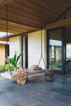 home boasts indoor/outdoor living that's complete with a relaxing bench swing to enjoy the Hawaiian breeze. Photo courtesy of Laure Joliet