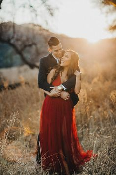 Red dress engagement photos engagement photo outfit ideas, semi-formal engagement photos, sunset engagement pictures. Letterboard engagement pictures.
