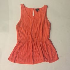 Ruffled Low Waisted Orange Tank Top ✨ Super cute ruffled waist orange tip. Perfect under a blazer. No stains or signs or signs of wear! Mossimo Supply Co Tops Blouses