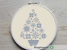 Christmas cross stitch pattern. Modern snowflakes christmas tree in blue/grey and red. Designed to fit a 9 inch embroidery hoop (stitched on 14 count aida).  Buy 4 patterns and get 25% discount! Place 4 patterns in your cart and enter the code HAPPINESST3AND1FREE at checkout and you get 25% discount.  The pattern comes as a PDF file that youll will be able to download immediately after purchase. In addition the PDF files are available in you Etsy account, under My Account and then Purchase…