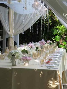 really. the clear plates with colored stemware and lush florals...love.