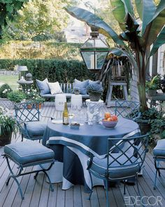 Vntage iron garden furniture dresses the terrace of Geoffrey Ross and John Dransfield's Hamptons house with outdoor fabrics from their own l...