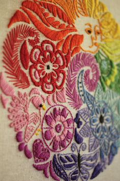 amazing embroidery! love the sunshine blowing rainbow flowers.