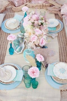 Beach wedding table decorations in soft pink and aqua