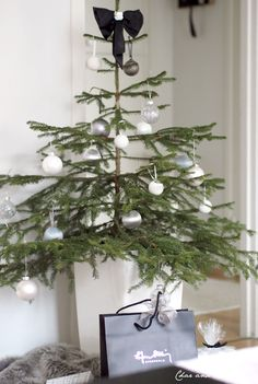 simply stylish - grey white and silver baubles on a natural Christmas tree - Char & the city blog