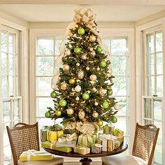 Green & Gold Tabletop Tree | If you have small kids, we suggest a tabletop tree to keep fragile ornaments and alluring packages out of reach. A wide burlap ribbon festoons this tree, cascading down the branches with casual elegance.