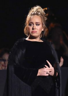 """Adele brought the Grammy Awards to a halt as she halted her George Michael tribute during the Grammy Awards. """"I'm sorry for swearing and sorry for starting again, can we please start it again. I'm sorry, I can't mess this up for you. I'm sorry."""""""