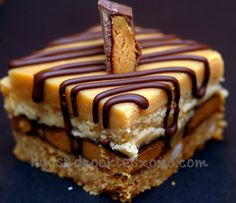 PEANUT BUTTER CHEESECAKE OVER PEANUT BUTTER CUPS SITTING ON A GRAHAM CRACKER CRUST & THEN TOPPED WITH PEANUT BUTTER GANACHE AND A CHOCOLATE DRIZZLE!