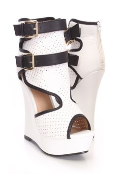 Doll up any outfit with these stylish wedges! They will look super hot paired with your favorite skinnies or dress. Make sure you add these to your closet, it definitely is a must have! The features include a faux leather upper with a perforated design, straps with buckle accents, peep toe, contrast trim, back zipper closure, smooth lining, and cushioned footbed. Approximately 5 1/4 inch wedge heels and 1 1/2 inch platforms.