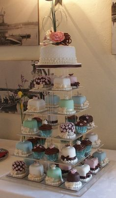 Mini sponge Wedding Cakes, Chocolate Cup Cakes, and a top rich fruit cake for cutting.  Picture taken at Cley Windmill, Norfolk.  More about my mini cakes at http://www.annescakecreations.co.uk/mini_cakes.html