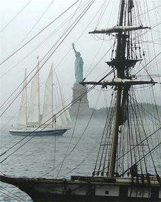 """New York Harbor. The sailing ship in front of the statue of Liberty is """"De Eendracht"""" a Dutch Training ship."""