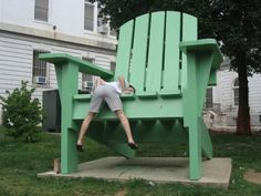 taking a seat on the giant adirondack chair- or at least trying to #ridecolorfully