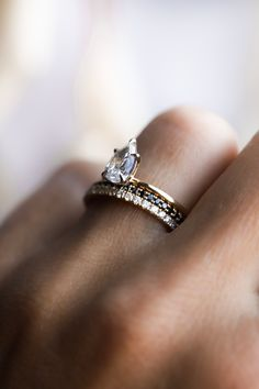 If you're looking to have a different look with your wedding band while still keeping your stones neutral, a black or salt and pepper diamond band is the perfect option! Here we have our medium twinkle with black diamonds and another medium twinkle with white diamonds. Both are shown here with our Laurel Engagement Setting.