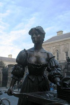 """Sweet Molly Malone on Grafton Street. """" In Dublin's fair city, where the girls are so pretty, where I first set eyes on sweet Molly Malone.  She pushed her wheel barrow through streets broad and narrow, singing cockles and mussels, alive, alive - o""""."""