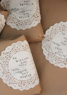 Use doilies and brown paper bags for a simple and clean yet pretty wrapping paper.  From robbie and erin blog.