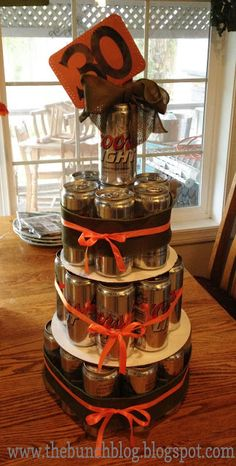 planning to make something like this for my hubby's 30th right around the corner! probably use a few long necks in there.. use angry orchard and budwiser!