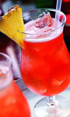 Reggae Rum Punch with Over Proofed Rum, OJ, Pineapple Juice, Lime Juice, Strawberry Syrup or Grenadine Syrup