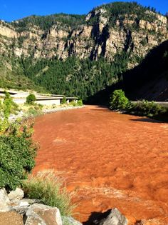 Colorado river running red through the Glenwood canyon.