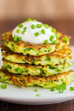 Zucchini Fritters are crisp on the edges with tender centers. These zucchini fritters are a kid-friendly family favorite. An easy summer zucchini recipe. Zucchini Fritters, Vegetable Recipes, Vegetarian Recipes, Cooking Recipes, Healthy Recipes, Healthy Zucchini, Recipe Zucchini, Diner Recipes, Vegetarian