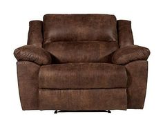 Settle in for your favorite TV show or relax with a good book in the Mosby recliner. Its mocha upholstery is rich yet neutral, making it a great fit for virtually any room. To go along with its generously scaled seat, the pillowed back and arms envelop you in softness, while the chaise-style seating offers outstanding support that extends from the back of the seat to the end of the footrest.
