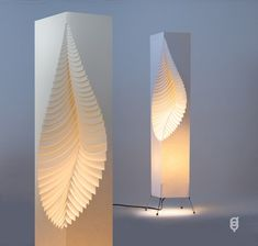thinking of column paper lampshades for our led programmable lights... Laminated MooDooNano paper leaf on wire stand lamp.