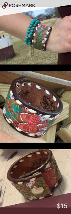 Painted leather cuff Handmade from a vintage tooled leather belt. Measures 71/2 inches Jewelry Bracelets
