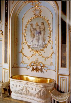 "Decorative Bath niche in Sir Antony Templestowe's dressing room with ""Thinking Tub"" - a Russian copper bathtub (minus its linen lining) set in a decorative plaster shell, with dressing stools either side. SALT REDUX"
