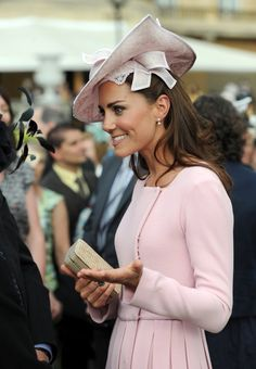 Kate Middletons Tiny Purse Collection | Photo Gallery - Yahoo! Shine Photo by: Getty Images  What's a garden party without a fabulous bag? Middleton greeted guests at Buckingham Palace's garden party on May 29, 2012 carrying LK Bennett's Natalie clutch ($248).