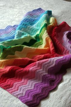 Rainbow ripple blanket by katieskitchenblog via Flickr.