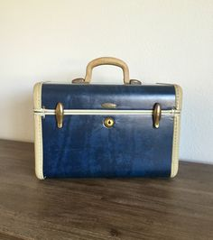 A personal favorite from my Etsy shop https://www.etsy.com/listing/490954130/blue-samsonite-train-case-with-key