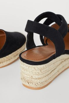 Wedge-heel sandals in faux suede with elasticized straps crossed over foot, covered toes, and braided jute trim around soles. Faux leather insoles and rubbe Espadrille Sandals, Espadrilles, Low Heels, Wedge Sandals, H&m Shoes, Fashion Company, Black Sandals, Black Women, Wedges