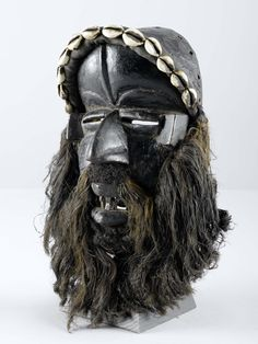 Africa   Mask from the Dan people of the Ivory Coast   Wood, natural fiber, hair and cowrie shells