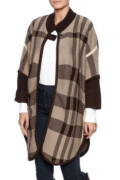 Camel plaid poncho with an open front, single button front closure, ribbed mock neck, 3/4 sleeves and a rounded hem.   Camel Plaid Poncho by High Secret. Clothing - Sweaters - Ponchos & Capes Kansas