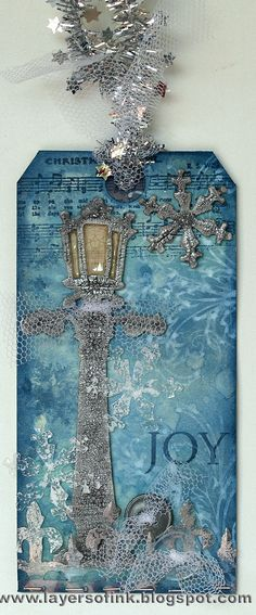 Beautiful blue tag with lamp post, snowflakes & music. This link takes you to more tags