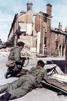 Against a background of ruined homes, British troops guard a strategic roadway position in their peacekeeping role in Belfast, Northern Ireland in 1969. (AP Photo/Peter Kemp) Ref #: PA.11408232