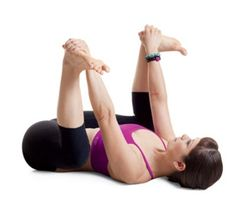 Dead Bug Pose  Lie on back and reach up to grab the out sides of feet. Try to bring knees toward the floor.  This pose is great for releasing the sacrum, so lower back needs to be on the floor (or mat) in order to get the full effect.