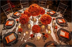 Rose infused tangerine tablescape adorned with silver accents and glimmering votives!