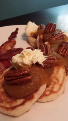 Spiced pancakes topped with pumpkin butter, candied pecans and whipped cream cheese.