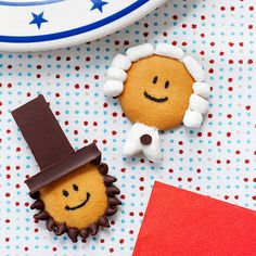 Pay tribute to a patriotic pair on Presidents' Day with these easy-to-assemble cookies. Each starts with a vanilla wafer head and a face drawn with black edible marker. Other features are attached with frosting applied with a toothpick. George's hair is made of mini marshmallows cut into pieces and rolled. His collar is a mini marshmallow flattened and snipped, then finished with a mini chocolate chip. Abe's top hat consists of trimmed sections of a chocolate bar, while his beard is formed…