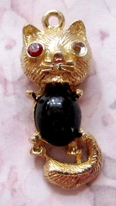 vintage gold tone casted cat charm with cabochon belly and rhinestone settings 30x13mm - f3010
