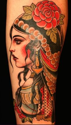 gypsy tattoo. I wish she would close her mouth or something, kind of has a dumb look on her face but otherwise beautiful
