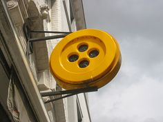 Giant yellow button sign